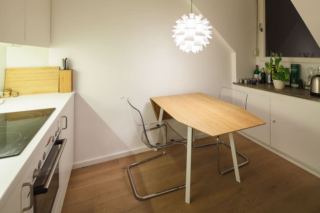 Fully equipped kitchen with fridge, oven range and a dining table