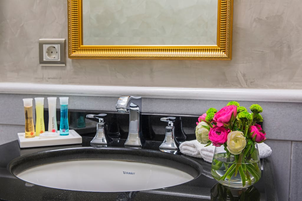 •The bathroom is decorated by marble tiles, once adorning palace floors, ceilings and walls, as a show of wealth and power.