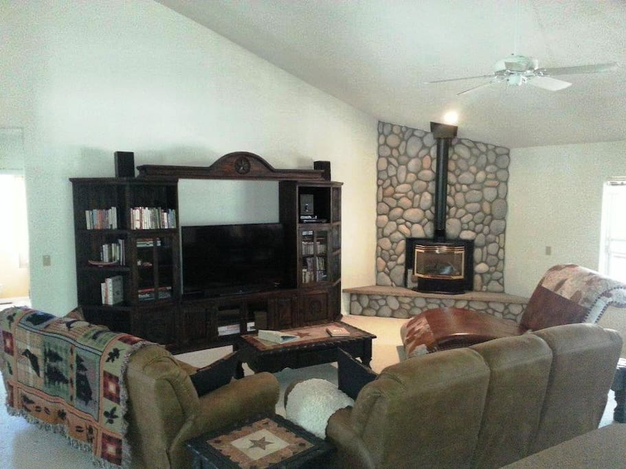 One of two large living rooms with large-screen TV, games, books & music & movies.