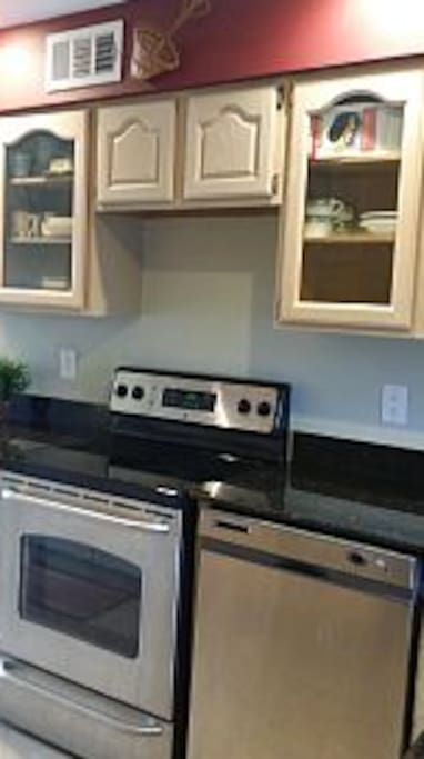 Stainless steel stove, glass cooktop.