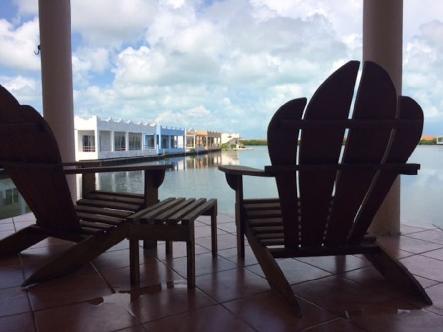 Relax on the outside balcony overlooking our community lagoon & island
