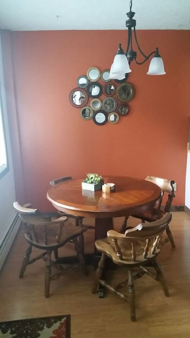 roomy dining area with large window facing yard and parking