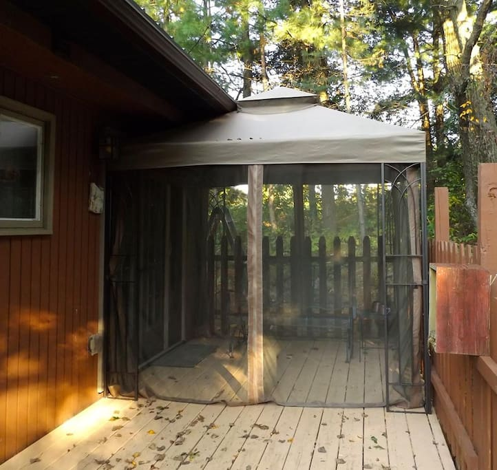The back deck includes a screen room, until the snow flies.