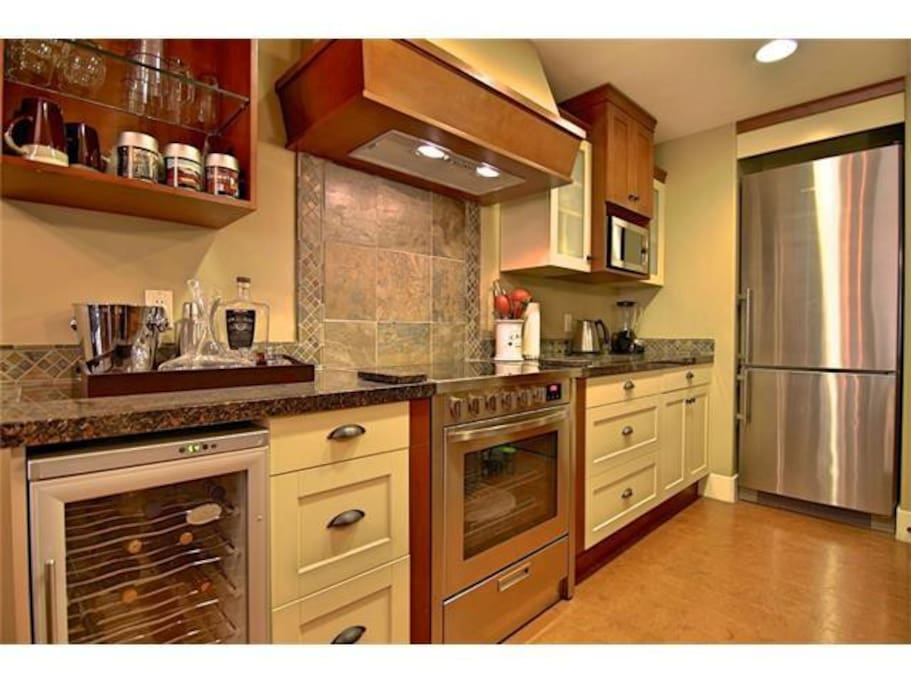 Kitchen includes separate wine fridge, glass cooktop, and Liebher Fridge/Freezer with ice maker.  Henckel Cookware.