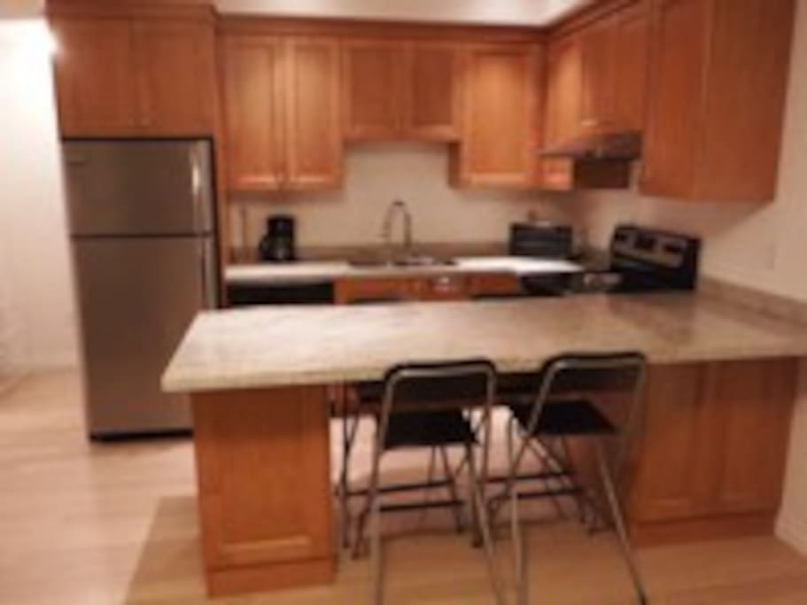 Open Kitchen, full oven and dishwasher. Counter seats 4.