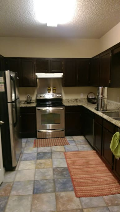 Newly remodeled! Granite countertops, stainless steel appliances, water purification, and everything you need to cook/eat with. Crock pot, juicer, blender, convection oven, basic herbs, condiments, etc...