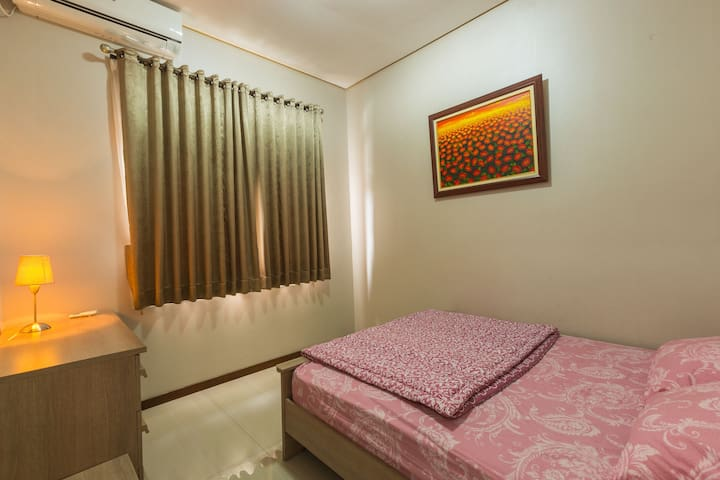 The 2nd room on 1st floor with queen size bed and equipped with AC