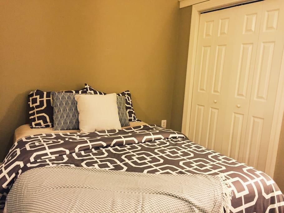 2nd bedroom with en-suite bathroom and queen size bed.
