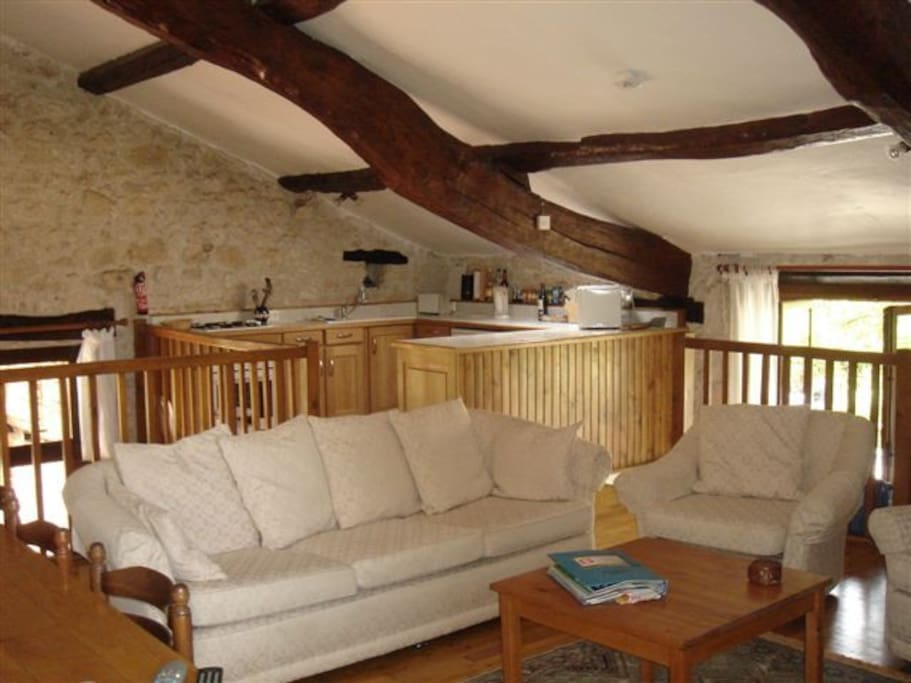 Couchant's living room - comfy sofas and spectacular beams!