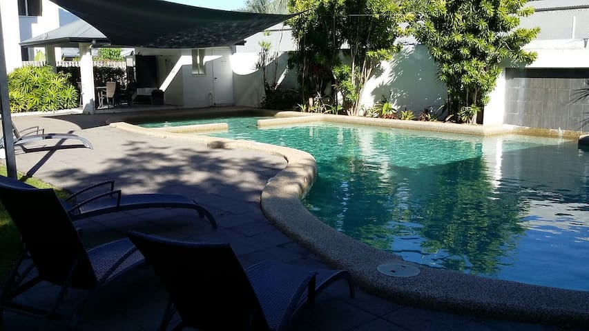 Tropical pool setting with a BBQ area
