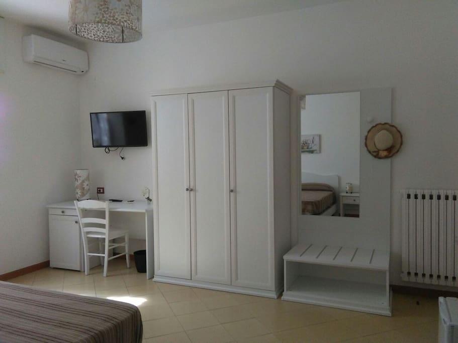 TV, air conditioning, heating, mirror, writing desk, wardrobe, minibar.
