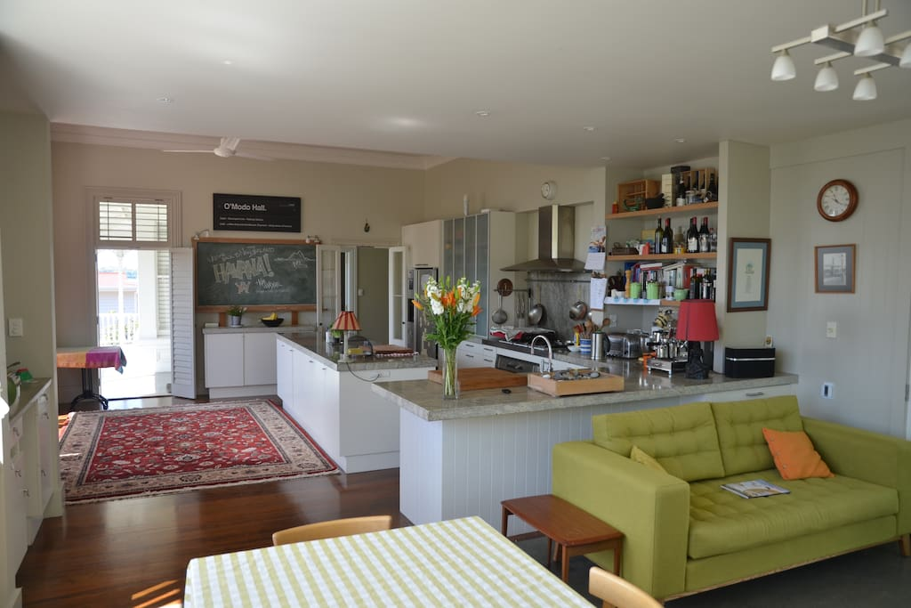 Chef's kitchen with large family living and dining area