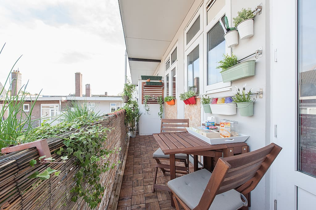 This nice spacious green balcony with herb garden and sunshine till 20:00 is my favorite place in the house. It is the best place to chill and unwind with a glass of unwine after a day of adventures in the city.