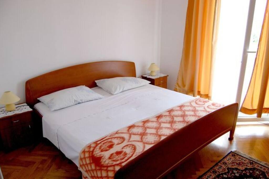 Matrimonial bed in sleeping room