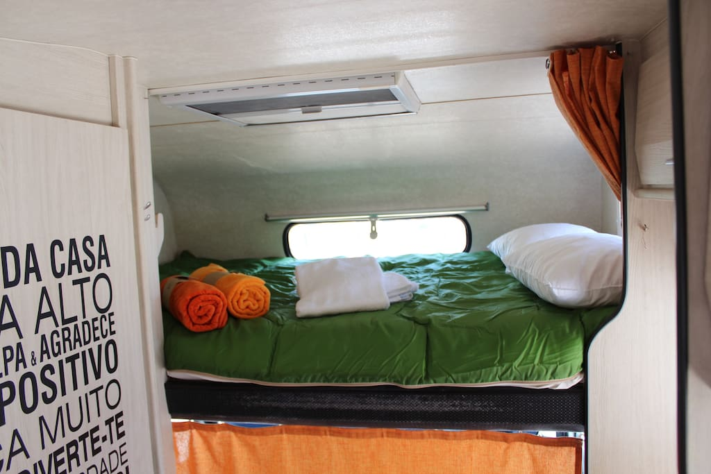King size bed, with bedding and bath towels