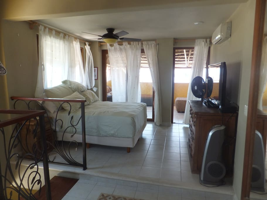 Master bedroom 4th floor palapa sitting area, flat screen TV, ensuite around corner