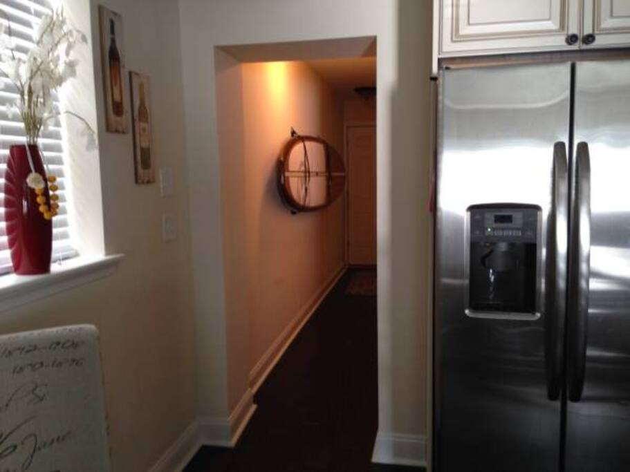 Hallway leads to one bathroom + two bedrooms