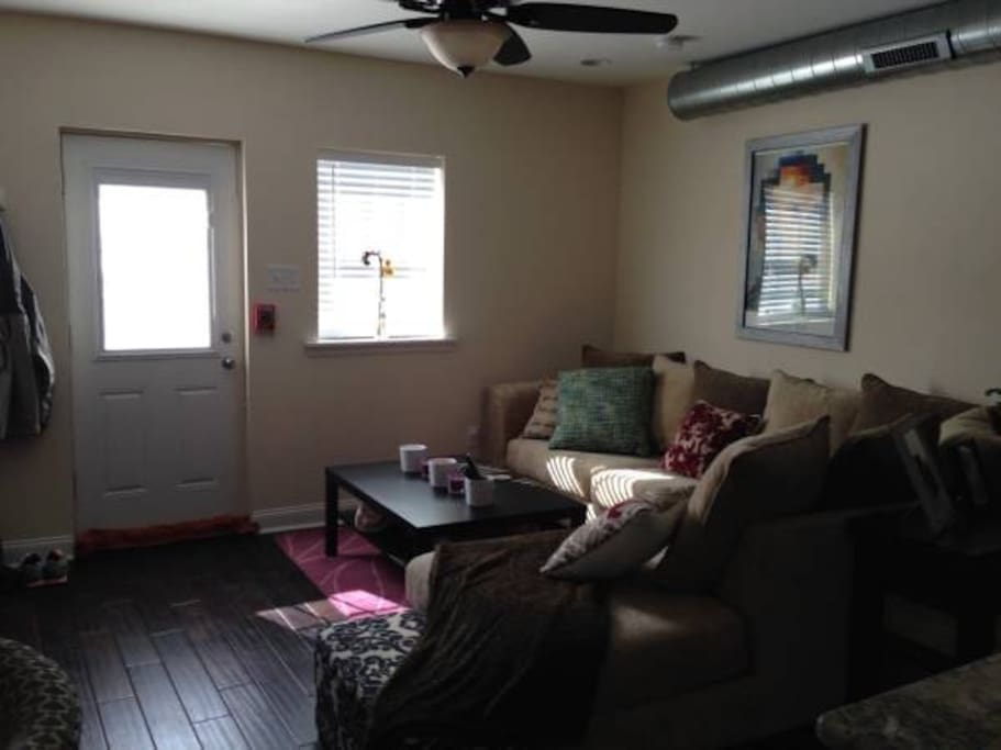 Large flat screen TV, comfy couch that can sleep two people, and a coffee table.