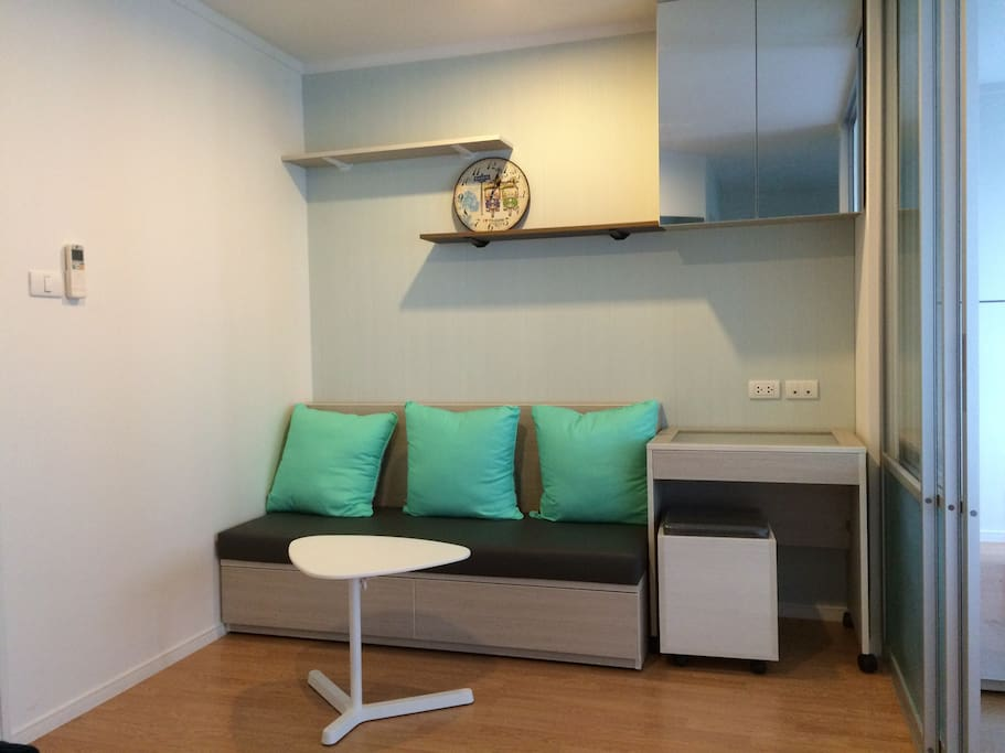 Three-seat sofa with small working desk.