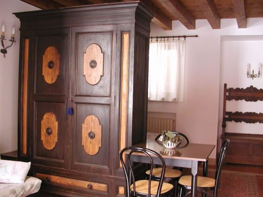 Antique armoire that divides Living Area from Sleeping Area