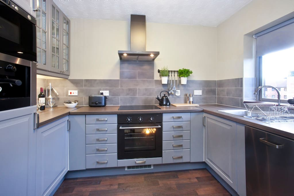 Modern fully equipped kitchen with built in coffee machine