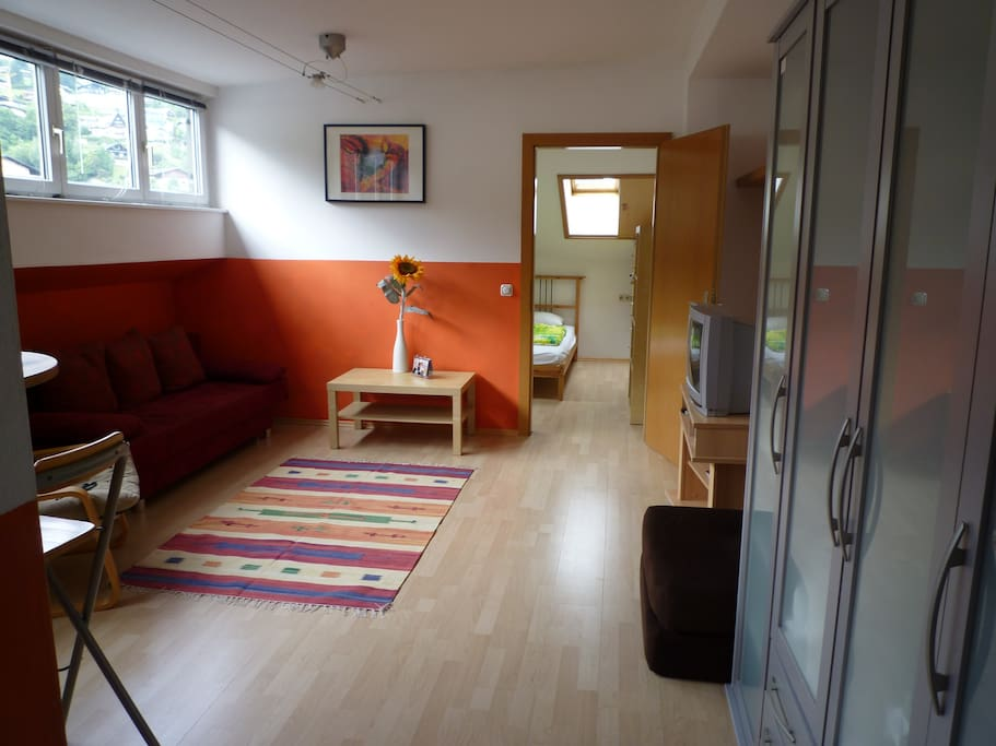 large light and airy modern lounge with double sofa bed, lots of storage, views to the ski slopes and mountains