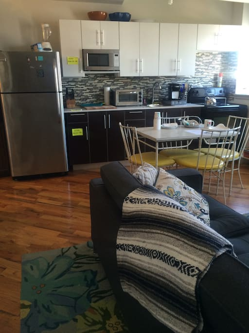 HUGE kitchen with coffee maker, toaster oven, stove with a lovely table to eat your meals at