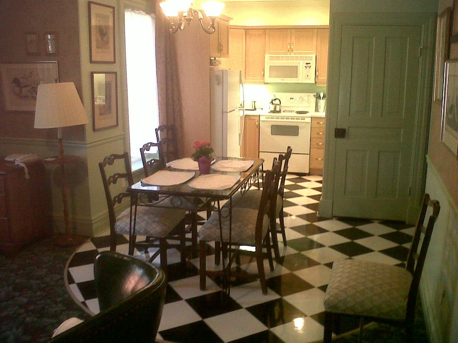 Glass top table, fully equipped kitchen (washer and dryer behind green door)