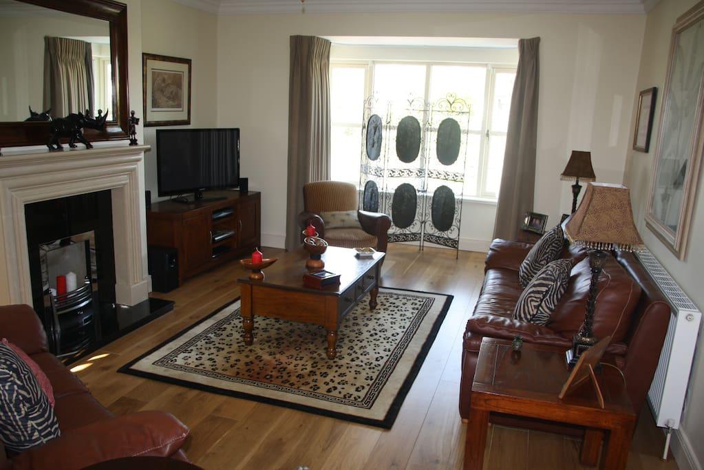 "Relaxation lounge 50""tv Bose surround sound."