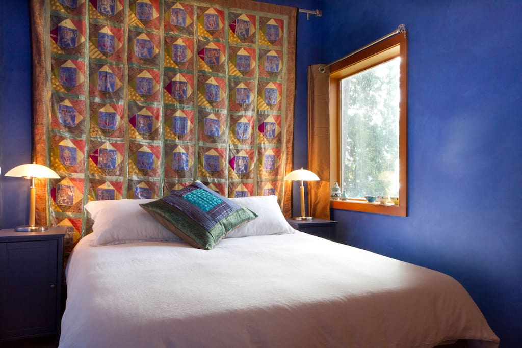 The bedroom is majorelle blue, with a new memory foam queen-sized bed.