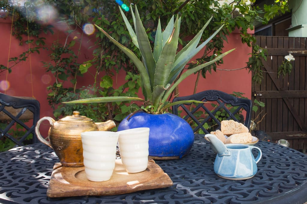 Enjoy a cup of tea in handmade ceramics at the outside breakfast table.