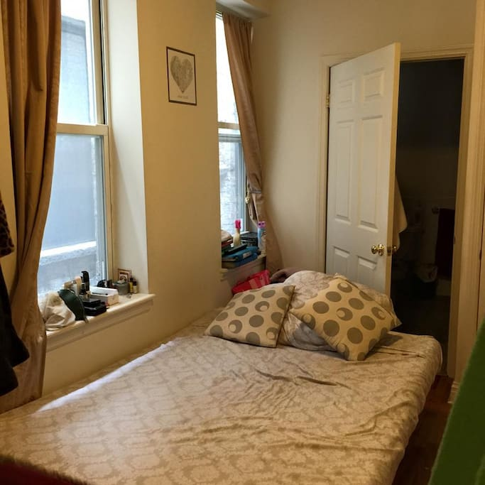 The room (the open door behind is the bathroom)