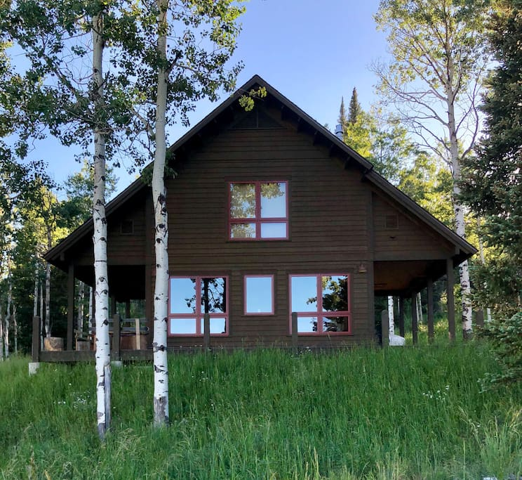 Sunset views from this gorgeous home on 5 acres. Nestled amongst aspens and old growth pine trees, get ready to fall in love.