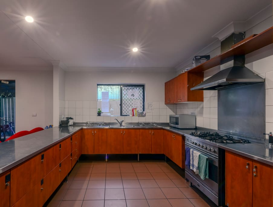 Large well-equipped communal kitchen.