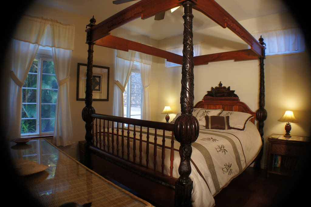 Beautiful Queen 4-Poster Bed in the separate bedroom with ceiling fan & a/c.