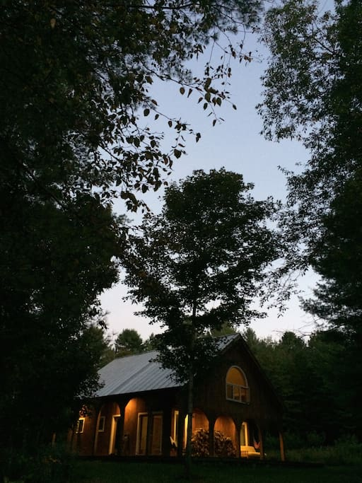 View of the cabin from the front at dusk.