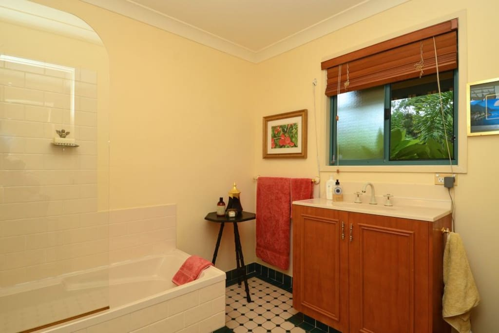 Large tiled bathroom with bath and shower