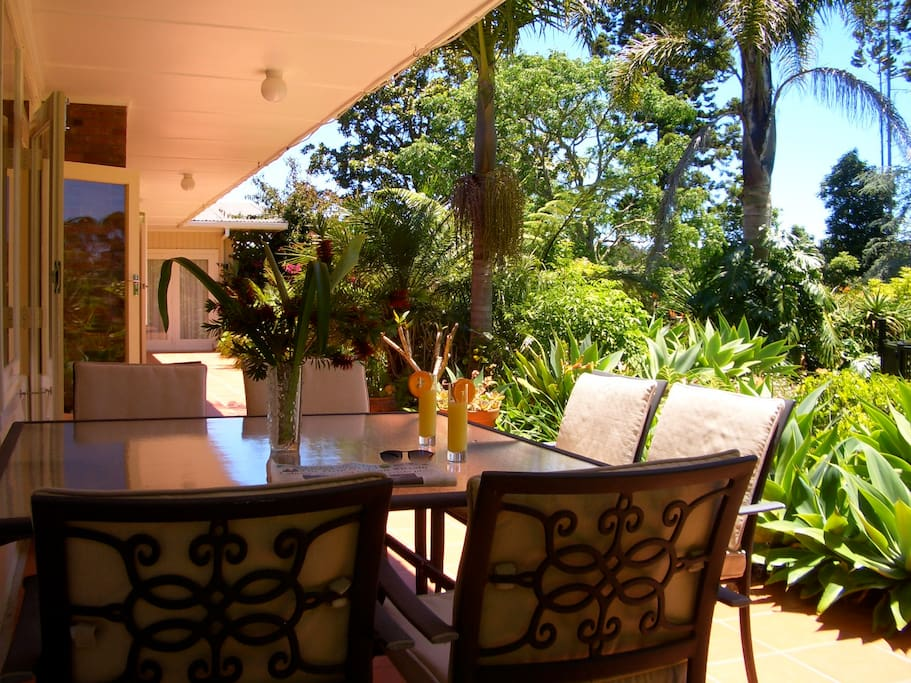The Sunny Veranda.  A great place to relax, view the gardens and socialize