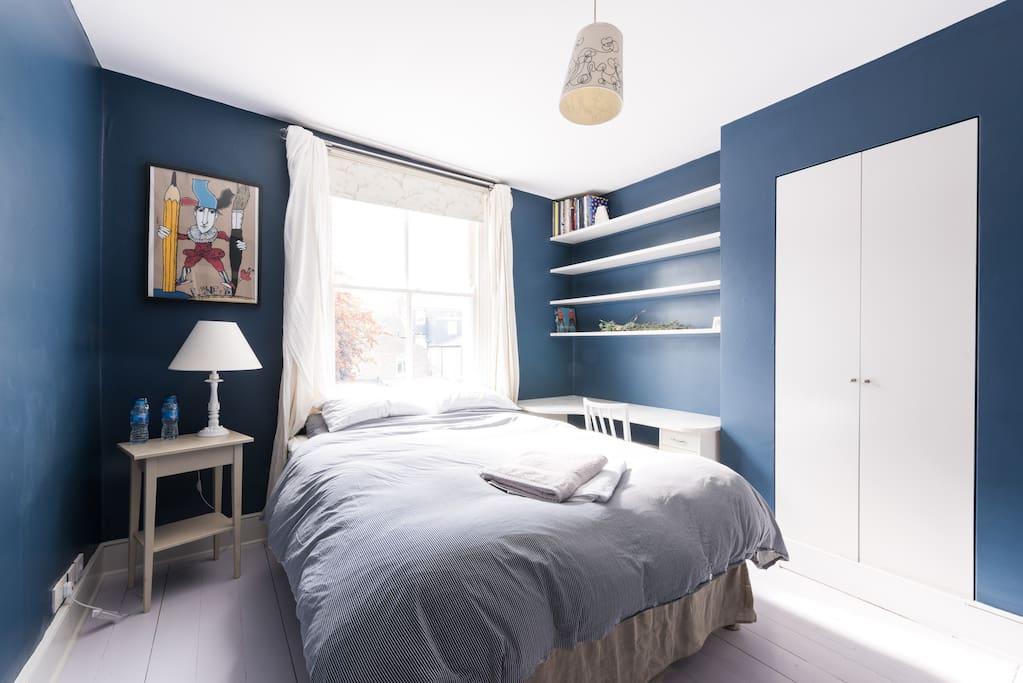 Lots of light in this double bedroom. Wardrobe, desk.