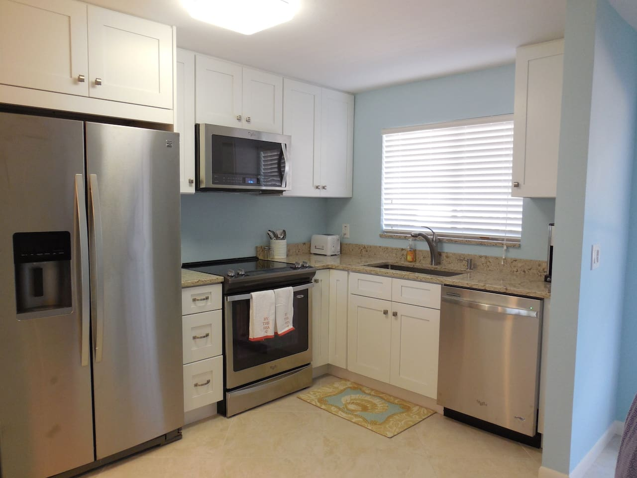 New remodeled kitchen with stainless appliances and granite counters