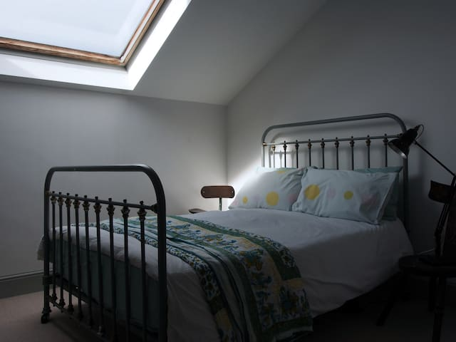 Clean and tidy bedroom with double bed.