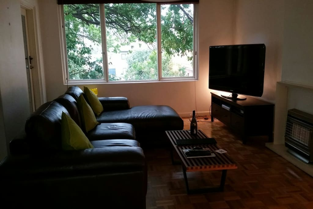 Cosy living room, with large tv, foxtel and external device connectivity and gas powered heater.