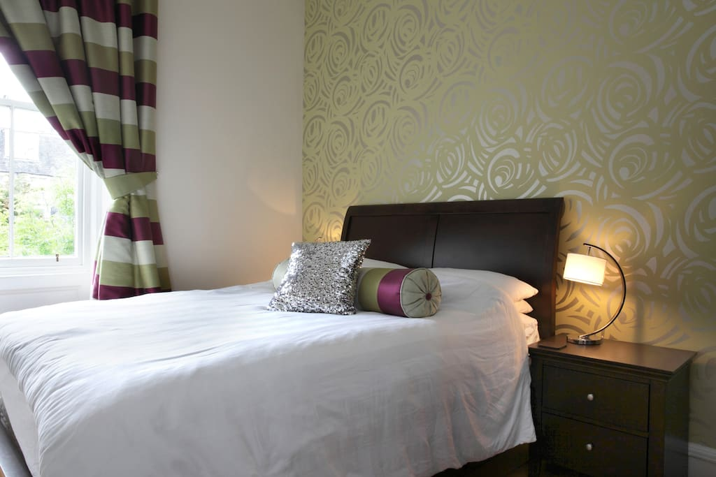 Double bedroom with wardrobe, mirror, bedside tables.  Quiet room facing the back garden.