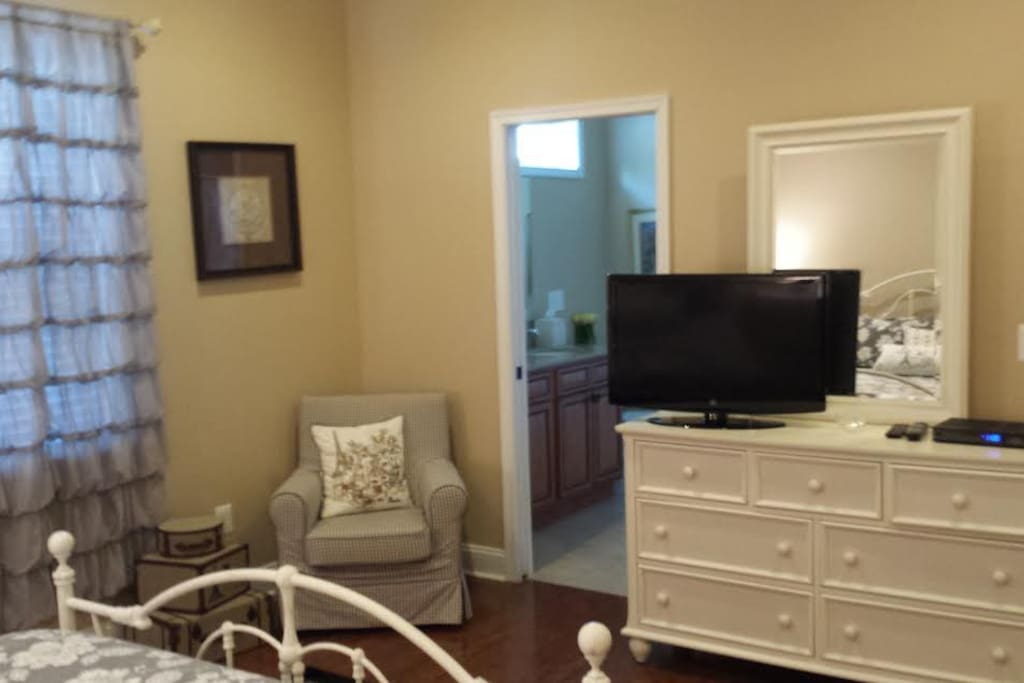 Triple dresser with mirror, cable tv. Chair for extra seating.