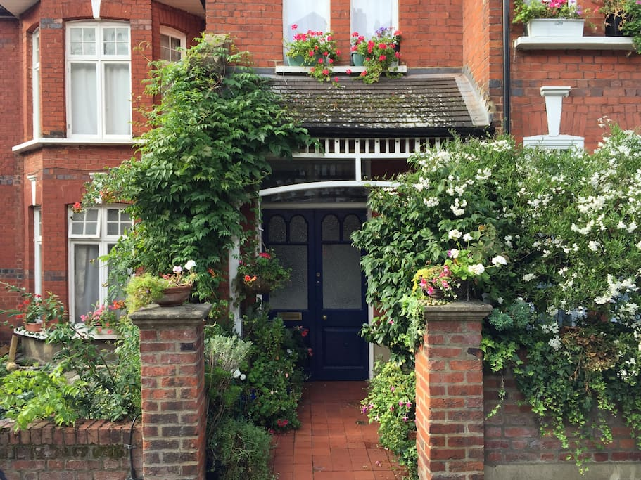 This is the entrance of the flat, a traditional red brick house.