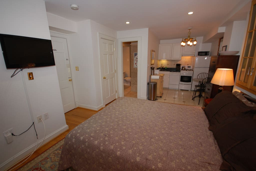 As a studio, it is essentially one large room. Queen bed, bureau, AC, ceiling fan, TV with satellite, full kitchen, full bath