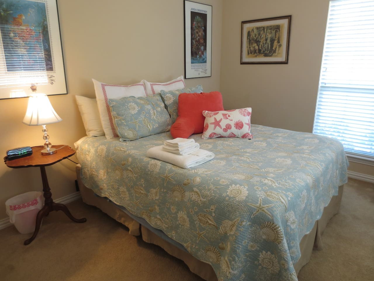 The bed with a reading lamp and plenty of pillows so you can relax with your laptop.