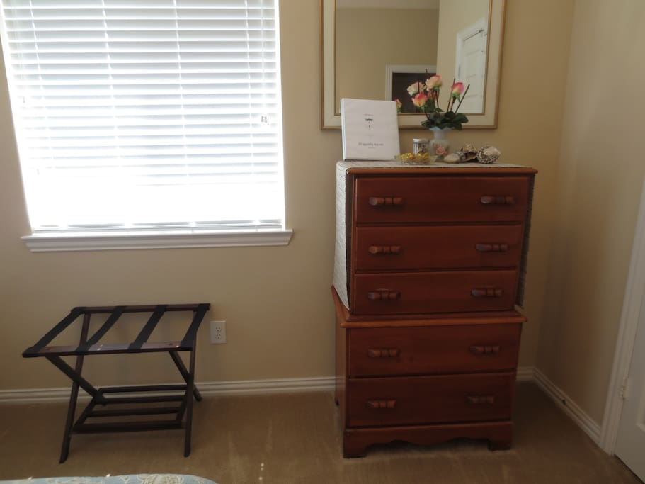 There's a luggage rack and a dresser so you can unpack and feel at home. On the dresser, you'll find a the house manual.