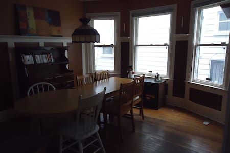 We have a large five-bedroom house and are renting out 2 rooms. The room can be furnished or unfurnished. The house has 5 bedrooms, 2 kitchens and 2 full bathrooms. We have a friendly dog named Daisy and are about a 15 minute bike from Midtown.