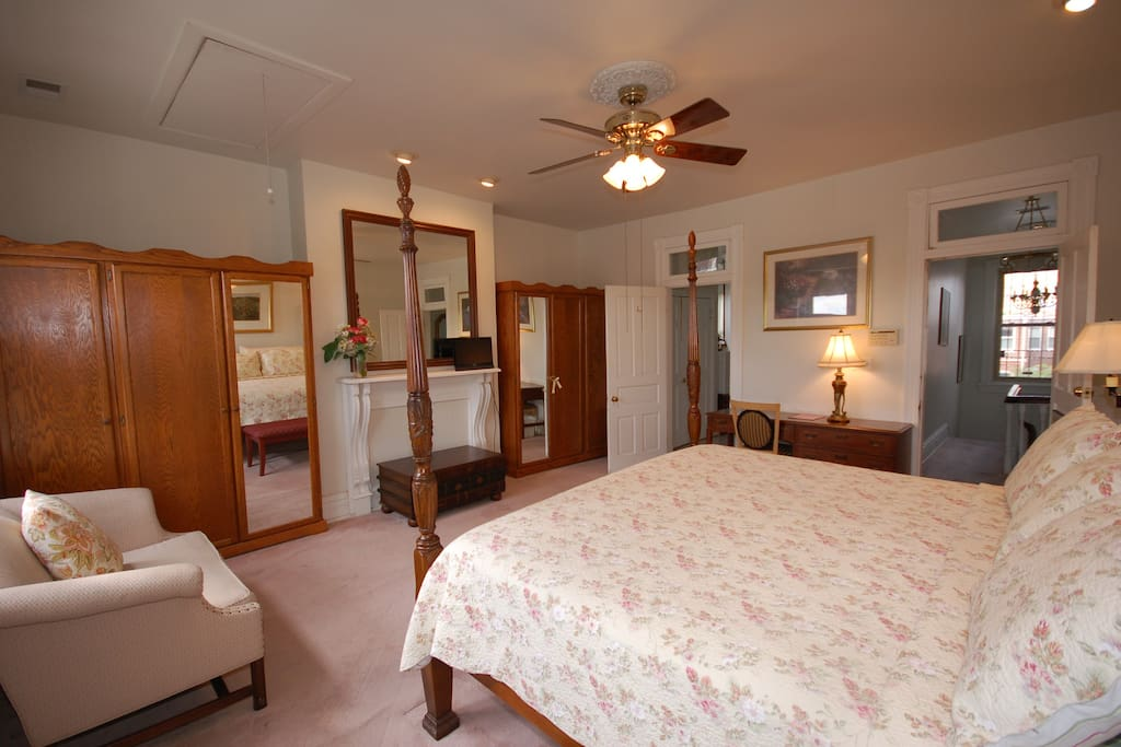 A large spacious room with king size bed and private bath. The fireplace is decorative only